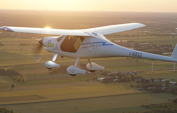 Electric airplane in sunset